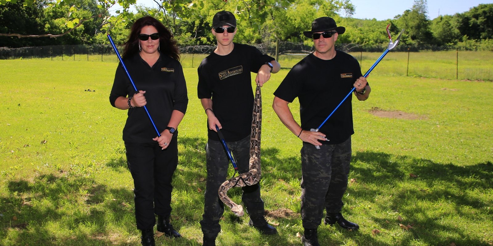Pierce Curran holds gaboon viper along with family members holding Midwest Tongs snake handling tools